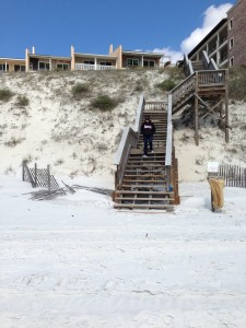 Annette Shope takes the steps to the beach.